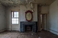Photo of a mirror in an abandoned, disused house.